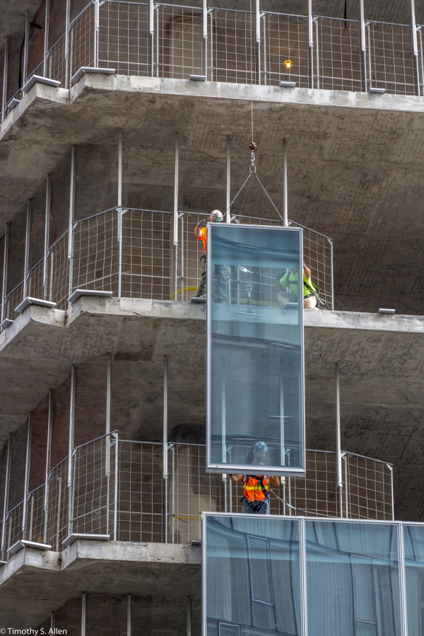 Installing Windows on a Skyscraper Being Built Near the Hudson River. New York, NY September 4, 2015