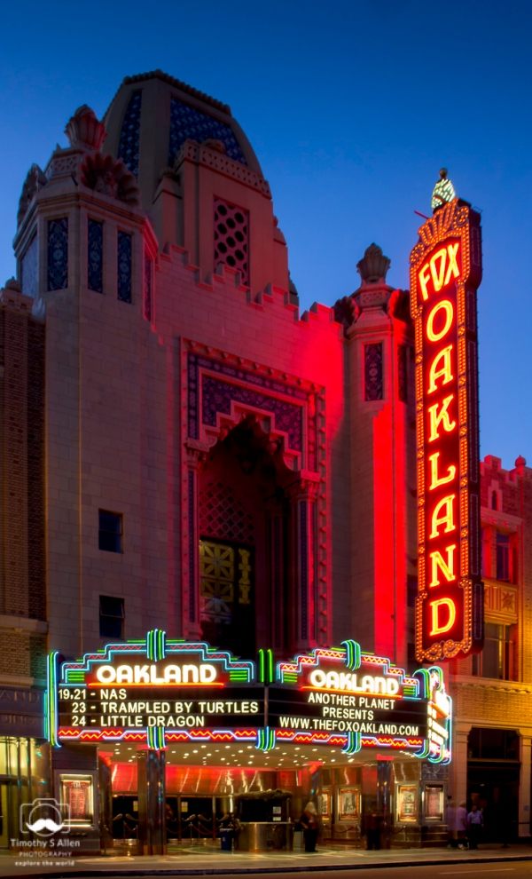 The auditorium of the Fox Theatre has a colorful East Indian Buddhist temple gloss applied over a standard squared off Weeks & Day interior. The entry portion of the main facade takes the form of a polychrome mosaic-like shrine, with smaller lantern-topped towers on either side. Trim with a Near Eastern flavor forms the cornice line for the remainder of the building.