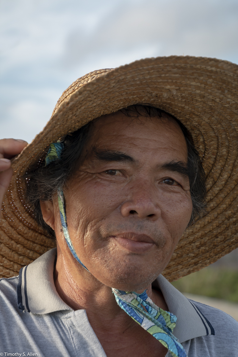 This man walks every late afternoon from one end of Cheng long Village to the other. That's about 1/2 kilometers each way. He seems to enjoy the walking. He's been generous to allow me to photograph him. Cheng long, Kohou Township, Yunlin County, Taiwan, May 06, 2018