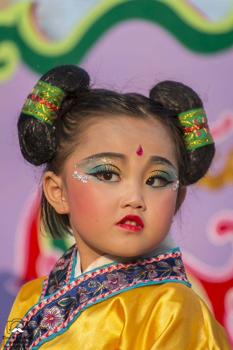 A young girl is dressed and made up to depict one of the Chinese traditional myths. She rides on a float in the Mazu Parade. Baigong, Yunlin County, Taiwan, May 4, 2018.