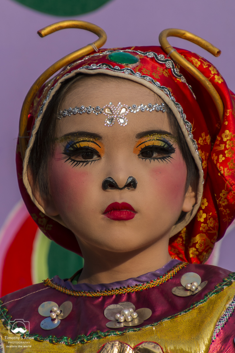 A young girl is made up to depict a character in a traditional Chinese story/myth. She rides on a float in the Mazu Parade. Beigang, Yunlin County, Taiwan, May 4, 2018.