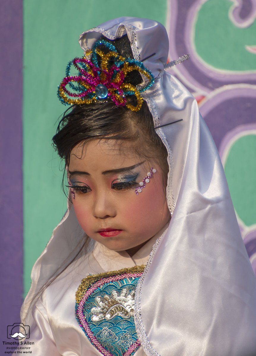 This young girl is made up to depict a character in a traditional Chinese story/myth. It must be a sad story because I never saw her smile. She rides on a float in the Mazu Parade. Beigang, Yunlin County, Taiwan, May 4, 2018.