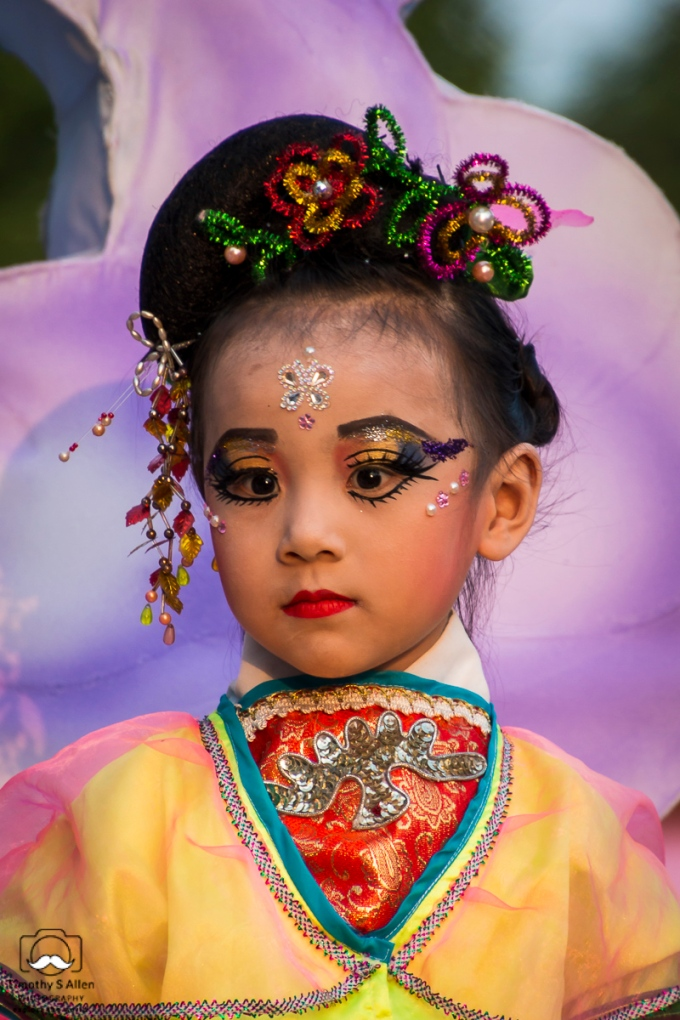 A young girl is dressed and made up to depict one of the Chinese traditional myths. She rides on a float in the Mazu Parade. Beigong, Yunlin County, Taiwan, May 4, 2018.