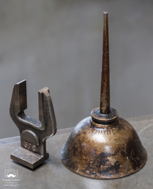 An oil can and wrench stand on a metal table ready to be used on a printing press. Sebastopol, CA, July 19, 2018