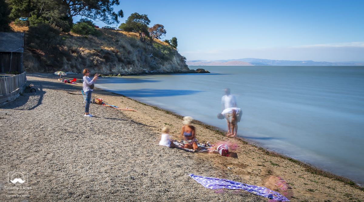 Bathers and visitors to China Camp State Park, San Rafael, CA. This was taken using a Neutral Density filter that helps reduce the amount of light captured by the camera's sensor. The shutter was open for 13 seconds. China Camp, San Rafael, CA, U.S.A. August 5, 2018