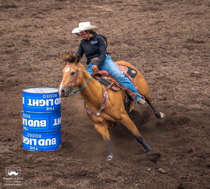 Barrel racing is a rodeo event in which a horse and rider attempt to complete a cloverleaf pattern around preset barrels in the fastest time. Russian River Rodeo, Duncans Mills, CA June 24, 2018