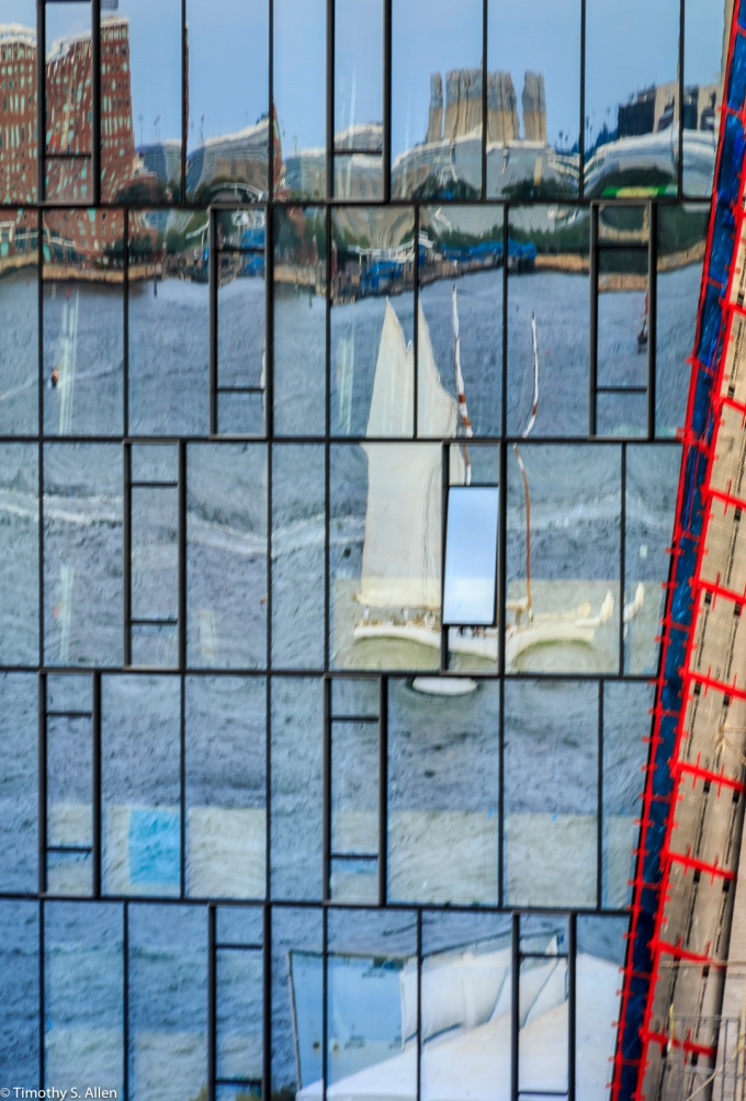 Glass front of a building under construction near the Fan Pier. Boston Harbor, Boston, MA August 31, 2018