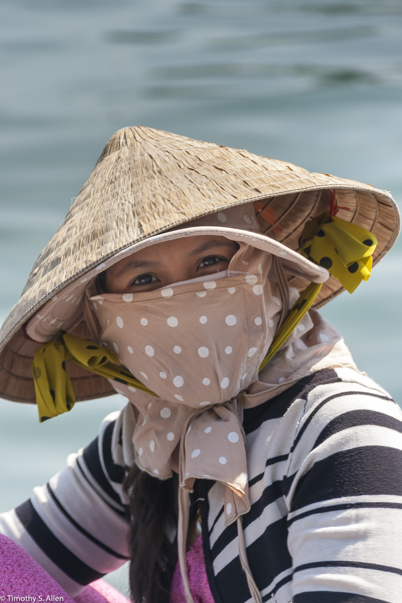 A Vietnamese women on Phu Quoy Island, Vietnam. She was cleaning newly caught squid for drying. Phu Quoy, Vietnam January 14, 2010
