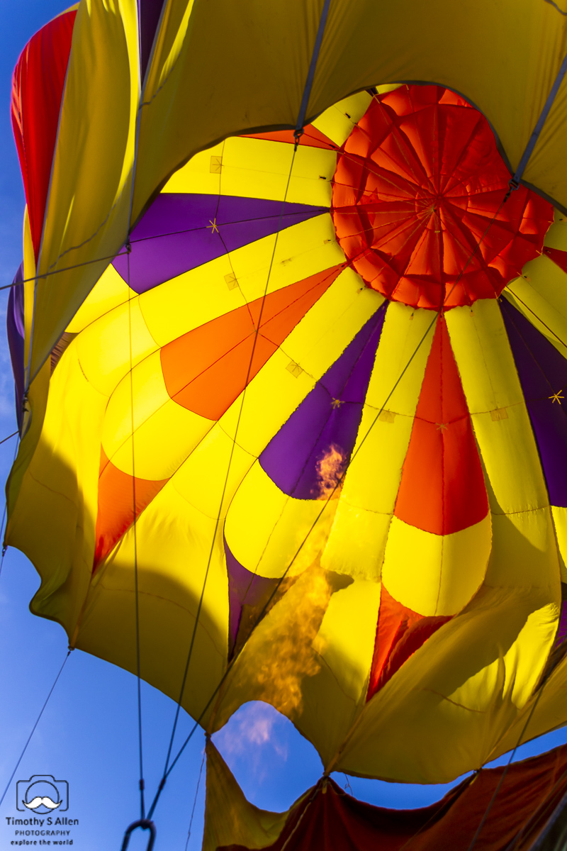 Lit gas is shot into a hot air balloon to inflate it. Sonoma County Hot Air Balloon Classic, Windsor, CA. June 14, 2014.
