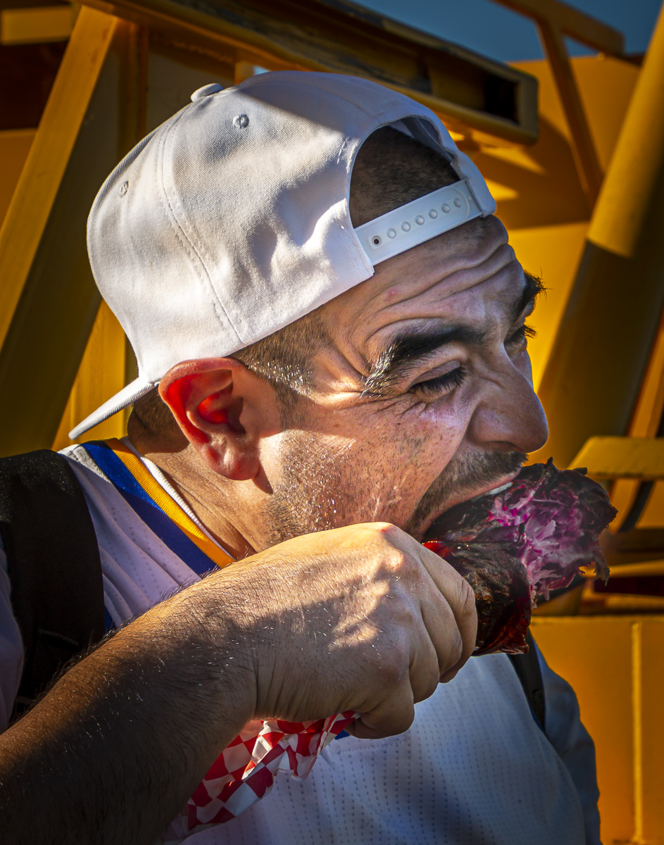 Person eating from a turkey leg