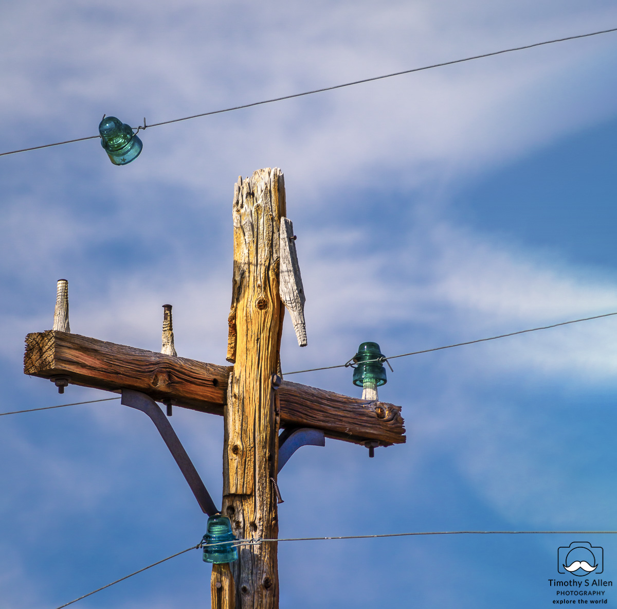 old wooden power pole and wires